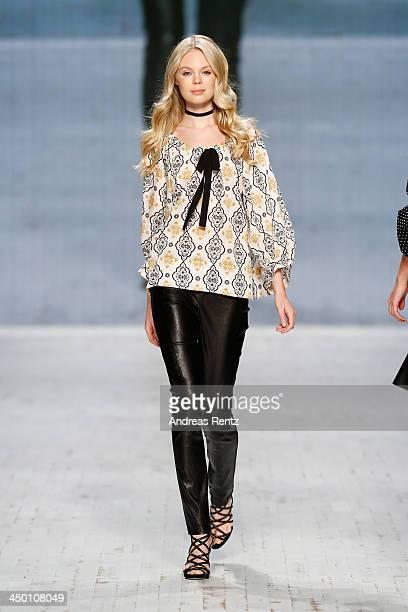 A model walks the runway at the Asandri show during MercedesBenz Fashion Days Zurich 2013 on November 16 2013 in Zurich Switzerland
