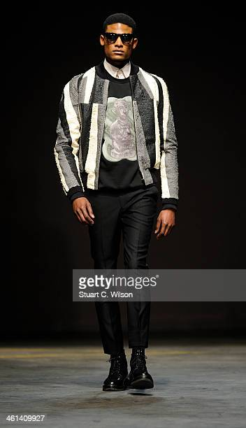 A model walks the runway at the ASauvage show during The London Collections Men Autumn/Winter 2014 on January 8 2014 in London England