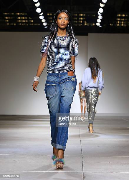 A model walks the runway at the Ashish show during London Fashion Week Spring Summer 2015 on September 16 2014 in London England