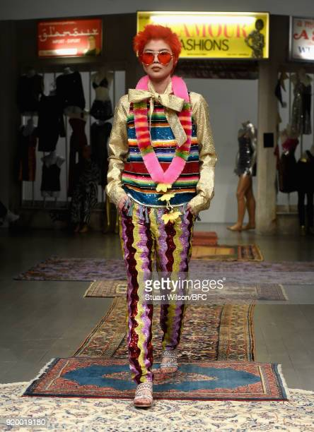 Model walks the runway at the Ashish show during London Fashion Week February 2018 at BFC Show Space on February 18, 2018 in London, England.