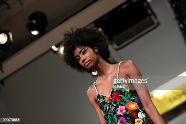 A model walks the runway at the Ashish show during London Fashion Week February 2018 at BFC Show Space on February 18 2018 in London England