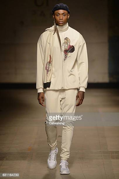 A model walks the runway at the Astrid Andersen Autumn Winter 2017 fashion show during London Menswear Fashion Week on January 7 2017 in London...