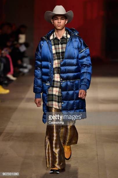 A model walks the runway at the Astrid Andersen Autumn Winter 2018 fashion show during London Menswear Fashion Week on January 7 2018 in London...
