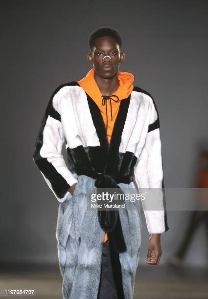 A model walks the runway at the Astrid Andersen show during London Fashion Week Men's January 2020 at the BFC Show Space on January 05 2020 in London...