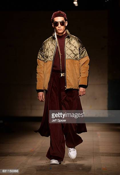 A model walks the runway at the Astrid Andersen show during London Fashion Week Men's January 2017 collections at Topman Show Space on January 7 2017...
