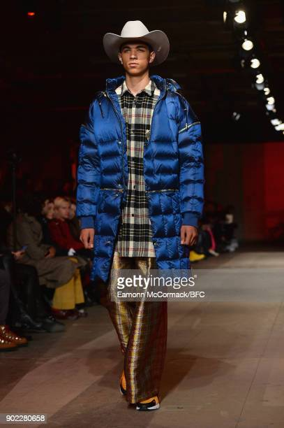 A model walks the runway at the Astrid Andersen show during London Fashion Week Men's January 2018 at Old Selfridges Hotel on January 7 2018 in...
