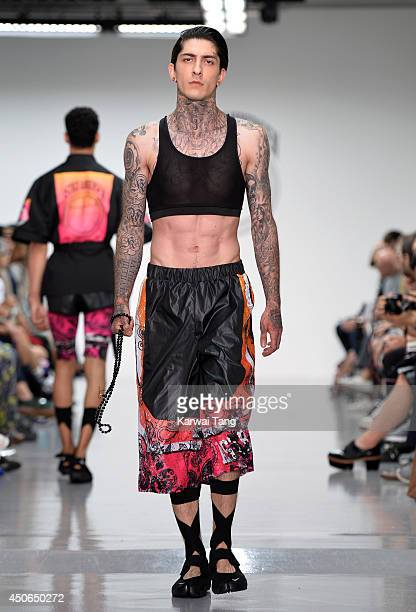 A model walks the runway at the Astrid Andersen show during the London Collections Men SS15 on June 15 2014 in London England