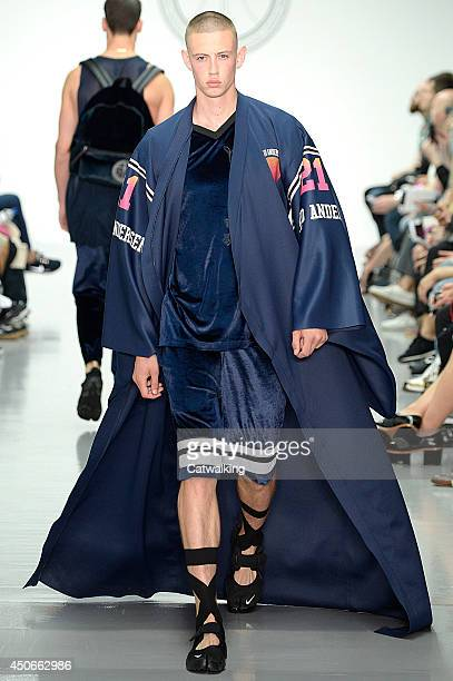 A model walks the runway at the Astrid Andersen Spring Summer 2015 fashion show during London Menswear Fashion Week on June 15 2014 in London United...