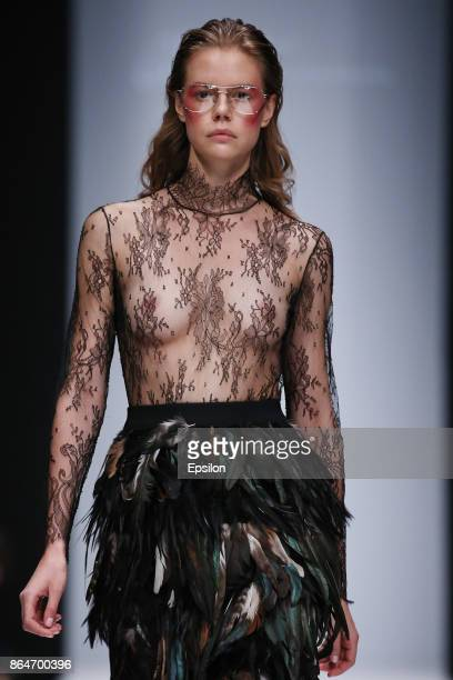 A model walks the runway at the Atelier B by Gala B fashion show during day one of Mercedes Benz Fashion Week Russia S/S 2018 at Manege on October 21...