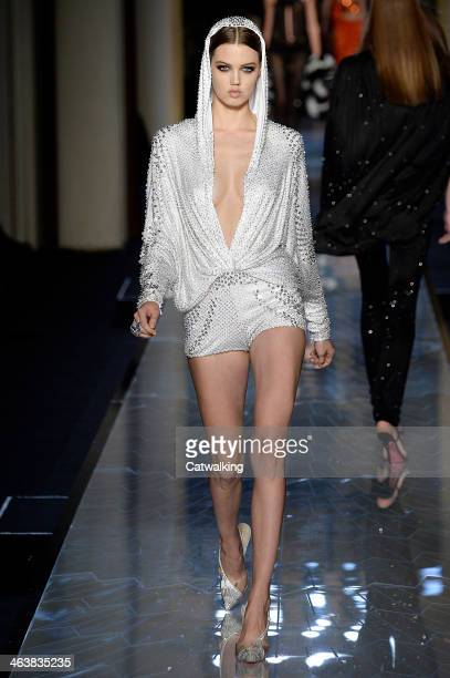 A model walks the runway at the Atelier Versace Spring Summer 2014 fashion show during Paris Haute Couture Fashion Week on January 19 2014 in Paris...