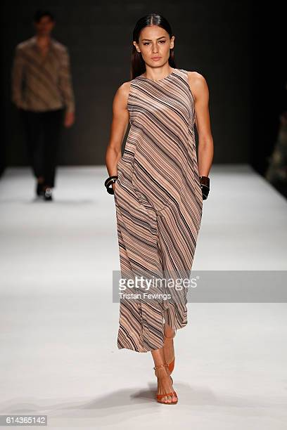 Model walks the runway at the Atil Kutoglu show during Mercedes-Benz Fashion Week Istanbul at Zorlu Center on October 13, 2016 in Istanbul, Turkey.