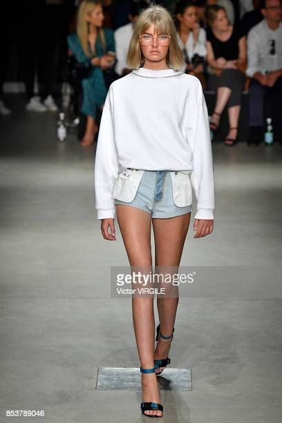 A model walks the runway at the Au Jour Le Jour Ready to Wear Spring/Summer 2018 fashion show during Milan Fashion Week Spring/Summer 2018 on...
