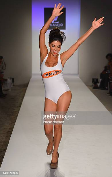 A model walks the runway at the AZ Araujo show during MercedesBenz Fashion Week Swim 2013 show at The Raleigh on July 23 2012 in Miami Beach Florida