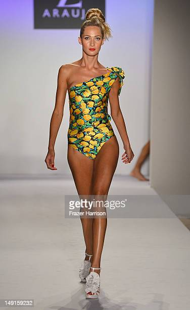 A model walks the runway at the AZ Araujo show during MercedesBenz Fashion Week Swim 2013 Official Coverage at The Raleigh on July 23 2012 in Miami...