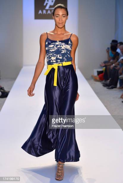 A model walks the runway at the AZ Araujo show during MercedesBenz Fashion Week Swim 2014 at Oasis at the Raleigh on July 21 2013 in Miami Florida