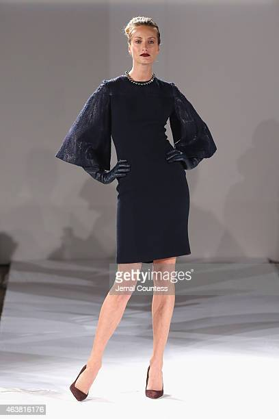 A model walks the runway at the B Michael America fashion show during MercedesBenz Fashion Week Fall at New York Public Library on February 18 2015...