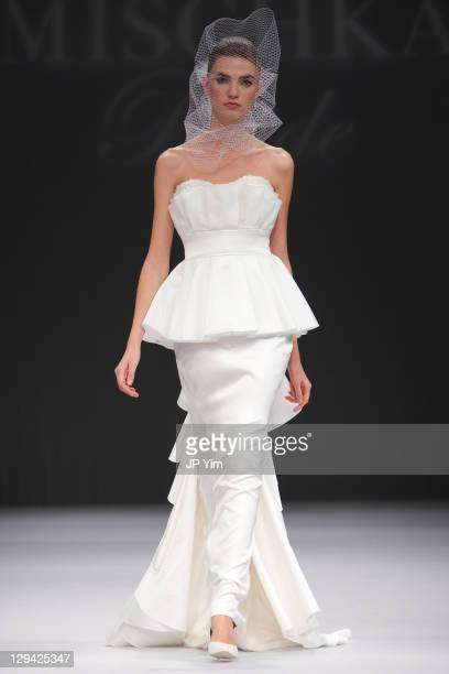 A model walks the runway at the Badgley Mischka Bride Spring 2012 show at Pier 94 on October 16 2011 in New York City