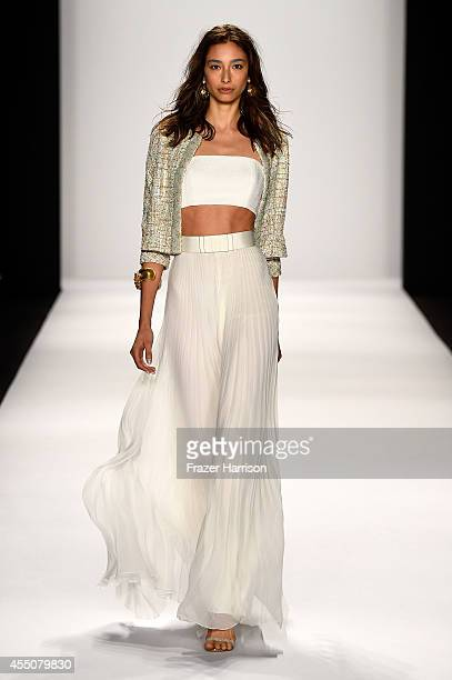A model walks the runway at the Badgley Mischka fashion show during MercedesBenz Fashion Week Spring 2015 at The Theatre at Lincoln Center on...