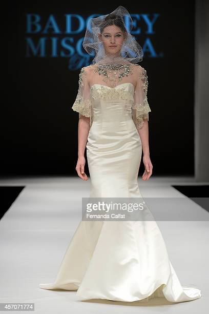 Model walks the runway at the Badgley Mischka Runway Show during Fall 2015 Bridal Collection at Pier 94- Fashion Theater on October 11, 2014 in New...