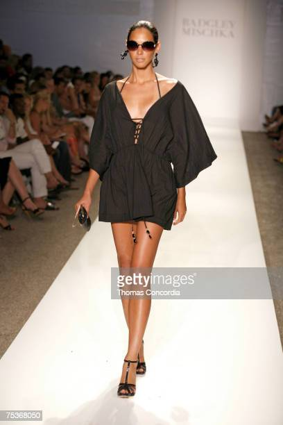 """Model walks the runway at the Badgley Mischka swimwear fashion show in the Beachway tent during """"Mercedes Benz Fashion Week: Miami Swim"""" at the..."""