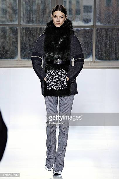 A model walks the runway at the Balenciaga Autumn Winter 2014 fashion show during Paris Fashion Week on February 27 2014 in Paris France