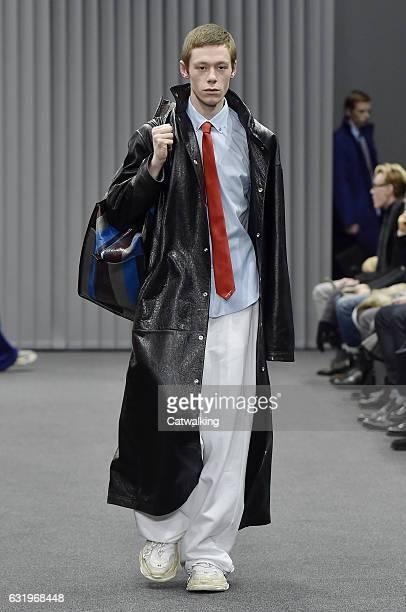A model walks the runway at the Balenciaga Autumn Winter 2017 fashion show during Paris Menswear Fashion Week on January 18 2017 in Paris France