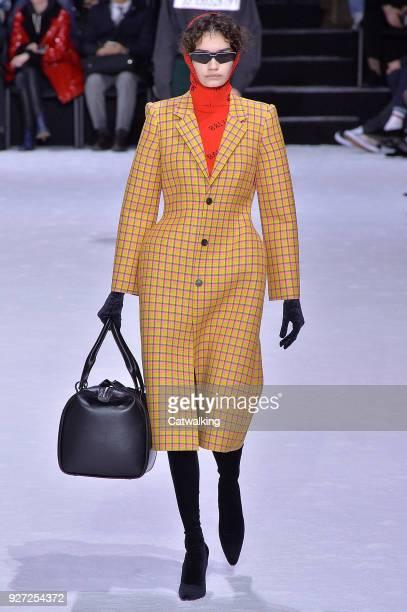 Model walks the runway at the Balenciaga Autumn Winter 2018 fashion show during Paris Fashion Week on March 4, 2018 in Paris, France.