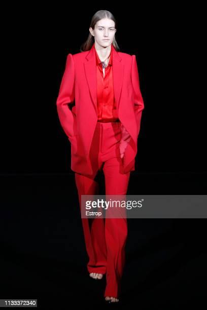 A model walks the runway at the Balenciaga fashion show at Paris Fashion Week Autumn/Winter 2019/20 on March 3 2019 in Paris France