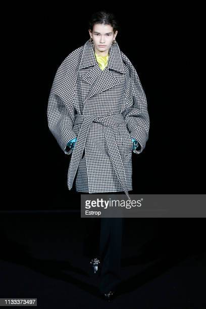 A model walks the runway at the Balenciaga fashion show at Paris Fashion Week Autumn/Winter 2019/20 on March 3 2019 in Paris France