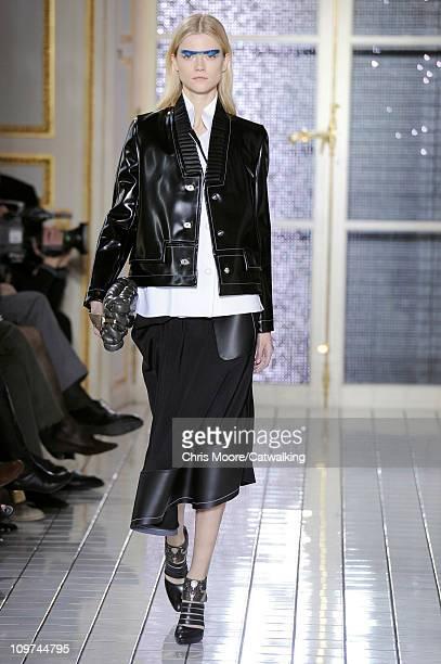 A model walks the runway at the Balenciaga fashion show during Paris Fashion Week on March 3 2011 in Paris France
