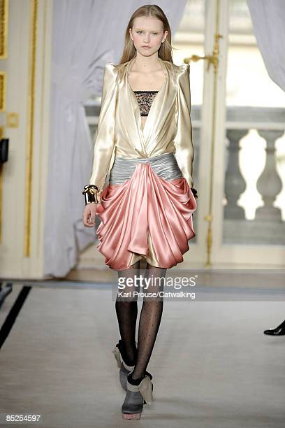 A model walks the runway at the Balenciaga ReadytoWear A/W 2009 fashion show during Paris Fashion Week on March 5 2009 in Paris France