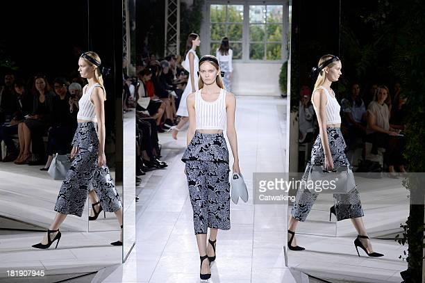 Model walks the runway at the Balenciaga Spring Summer 2014 fashion show during Paris Fashion Week on September 26, 2013 in Paris, France.