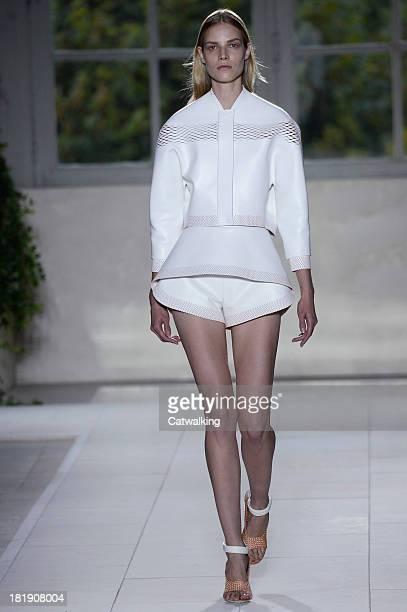 A model walks the runway at the Balenciaga Spring Summer 2014 fashion show during Paris Fashion Week on September 26 2013 in Paris France