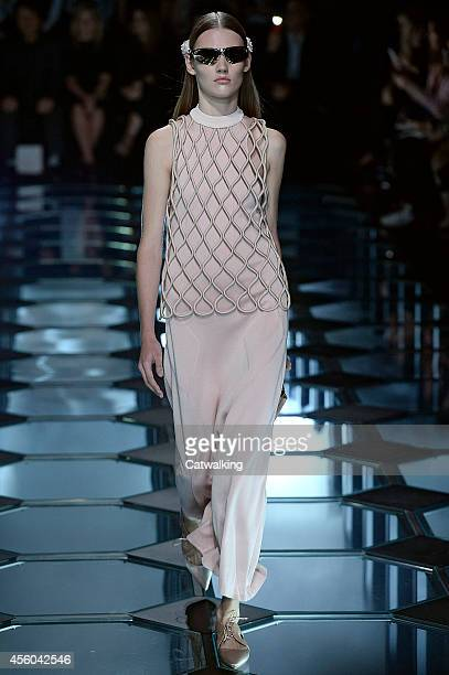 A model walks the runway at the Balenciaga Spring Summer 2015 fashion show during Paris Fashion Week on September 24 2014 in Paris France
