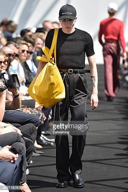 A model walks the runway at the Balenciaga Spring Summer 2017 fashion show during Paris Menswear Fashion Week on June 22 2016 in Paris France