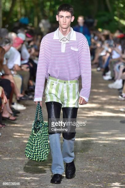 Model walks the runway at the Balenciaga Spring Summer 2018 fashion show during Paris Menswear Fashion Week on June 21, 2017 in Paris, France.