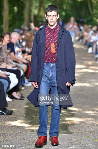A model walks the runway at the Balenciaga Spring Summer 2018 fashion show during Paris Menswear Fashion Week on June 21 2017 in Paris France