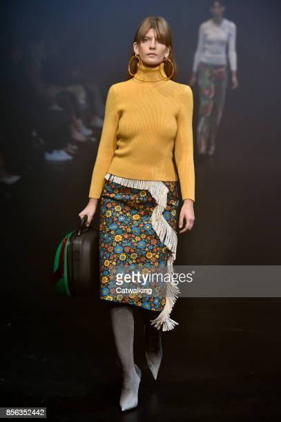 A model walks the runway at the Balenciaga Spring Summer 2018 fashion show during Paris Fashion Week on October 1 2017 in Paris France
