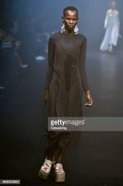 A model walks the runway at the Balenciaga Spring Summer 2018 fashion show during Paris Fashion Week on October 1 2017 in Paris France