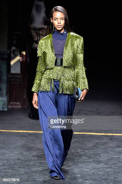 A model walks the runway at the Balmain Autumn Winter 2015 fashion show during Paris Fashion Week on March 5 2015 in Paris France