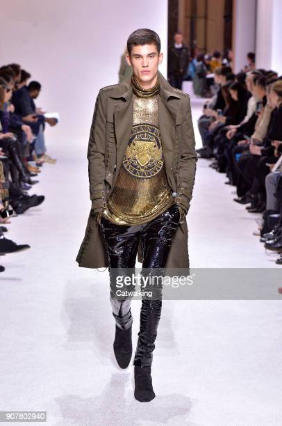 A model walks the runway at the Balmain Homme Autumn Winter 2018 fashion show during Paris Menswear Fashion Week on January 20 2018 in Paris France