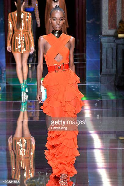 A model walks the runway at the Balmain Spring Summer 2016 fashion show during Paris Fashion Week on October 1 2015 in Paris France