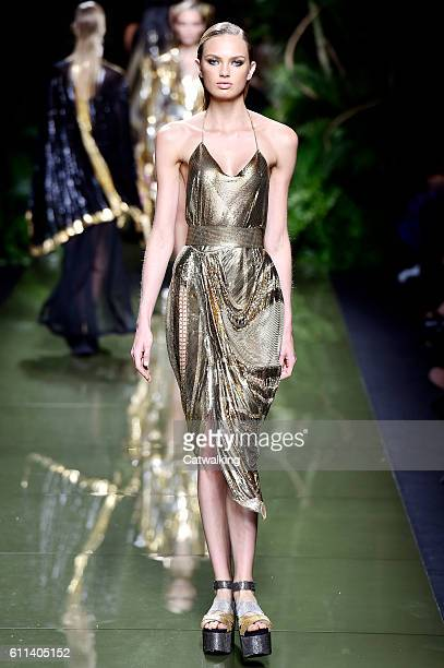 A model walks the runway at the Balmain Spring Summer 2017 fashion show during Paris Fashion Week on September 29 2016 in Paris France