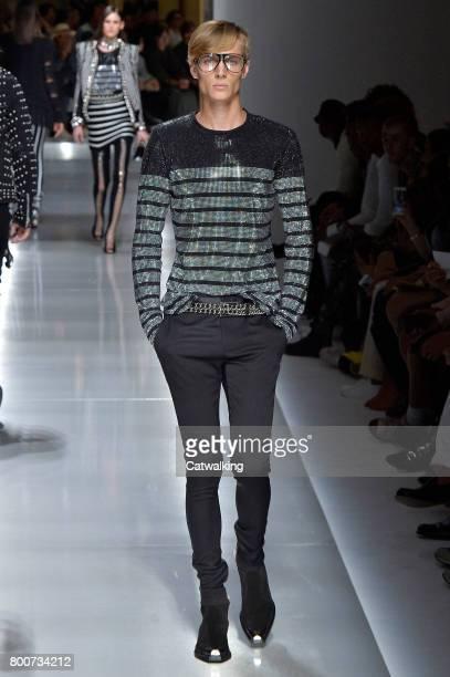 Model walks the runway at the Balmain Spring Summer 2018 fashion show during Paris Menswear Fashion Week on June 24, 2017 in Paris, France.
