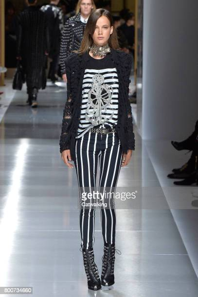 A model walks the runway at the Balmain Spring Summer 2018 fashion show during Paris Menswear Fashion Week on June 24 2017 in Paris France