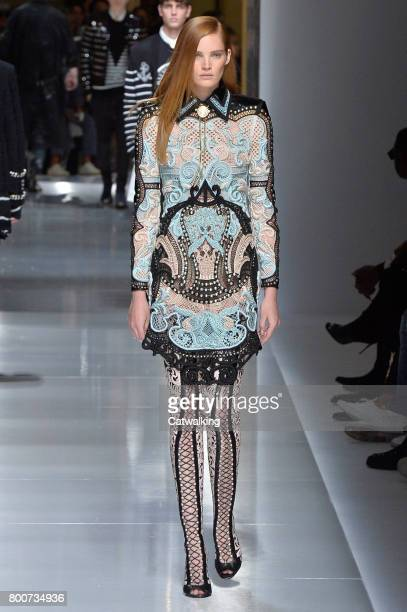 A model walks the runway at the Balmain Spring Summer 2018 fashion show during Paris Menswear Fashion Week on June 24 2017 in Paris France