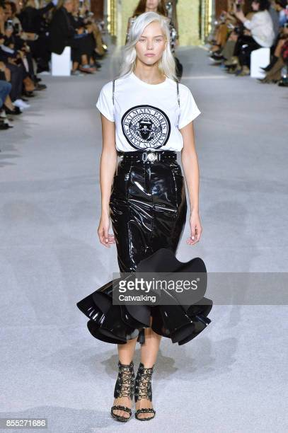 A model walks the runway at the Balmain Spring Summer 2018 fashion show during Paris Fashion Week on September 28 2017 in Paris France