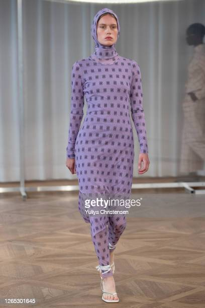 Model walks the runway at the Baum Und Pferdgarten show during the Copenhagen Fashion Week Spring/Summer 2021 on August 11, 2020 in Copenhagen,...