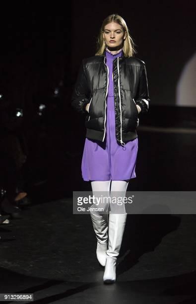 A model walks the runway at the Baum und Pferdgarten show during the Copenhagen Fashion Week Autumn/Winter18 on February 1 2018 in Copenhagen Denmark