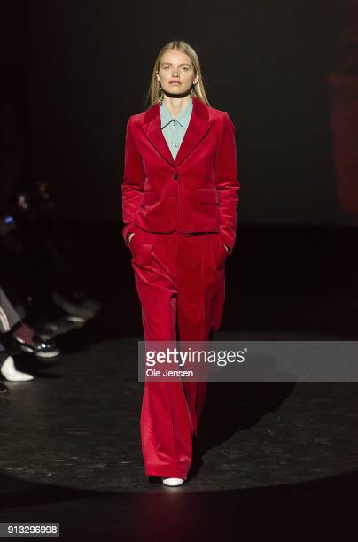 A model walks the runway at the Baum und Pferdgarten show during the Copenhagen Fashion Week Autumn/Winter18 on February 1 2018 in Copenhagen Denmark
